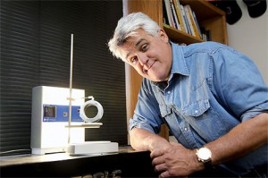Jay Leno with a 3D printed 1907 White Steamer feedwater heater.