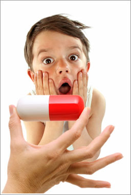 Surprised Boy Looking at a Big Pill
