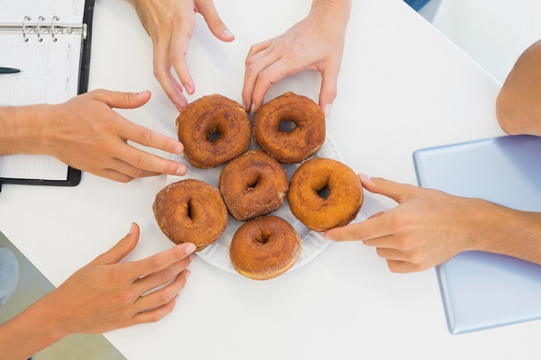Hands Grabbing For Doughnuts